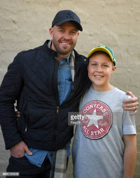 14yearold Leo Sadler poses for a portrait with his role model AB de Villiers at his home during an arranged surprise meeting on June 05 2018 in...