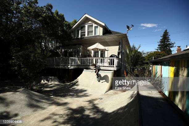 Year-old Olympic hopeful skateboarder Minna Stess trains in her backyard on May 19, 2020 in Petaluma, California. While most of the skateparks in...