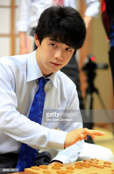 14yearold professional shogi player Sota Fujii reacts after his victory in the Ryuo Title Qualifying Group 6 match against Seiya Kondo at Shogi...