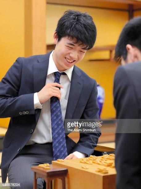 14yearold shogi player Sota Fujii smiles after his victory over Hayata Fujioka in the Asahi Cpu Shogi Open Championship at Kansai Shogi Kaikan on...