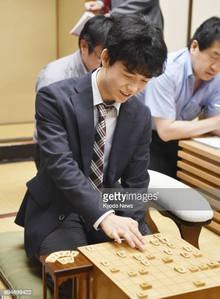 14yearold Sota Fujii youngest professional 'shogi' Japanese chess player reviews a match against Ryuma Tonari in Tokyo on June 10 after extending his...