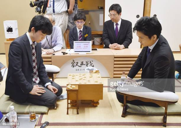 14yearold Sota Fujii youngest professional 'shogi' Japanese chess player beats Ryuma Tonari in a game in Tokyo on June 10 extending his record...