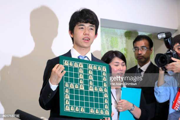 14yearold youngest professional shogi player Sota Fujii attends a press conference after his victory in the Ryuo title tournament round against...