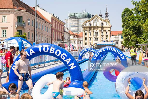 150-meter water slide on  congress square in ljubljana, slovenia - editorial stock pictures, royalty-free photos & images