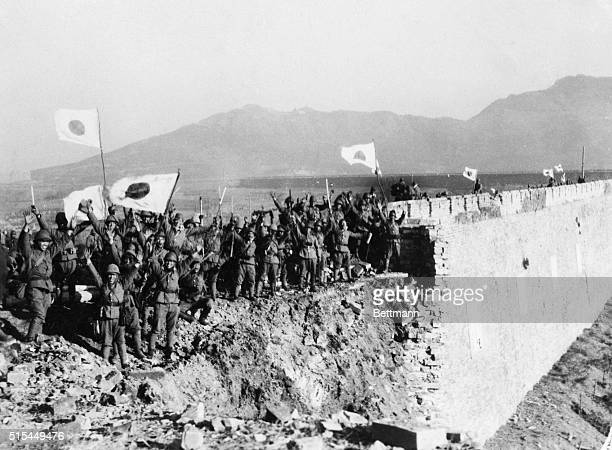 1/5/1938Nanking China BANZAI NANKING FALLS TO JAPAN Thus do Japanese troops grouped on the shelltorn wall around Nanking cheer as the Chinese capital...