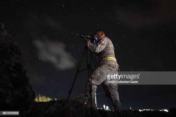 154th Wing Public Affairs broadcast journalist Senior Airman Orlando Corpuz documenting the ongoing volcanic outbreak at Leilani Estates, Pahoa,...