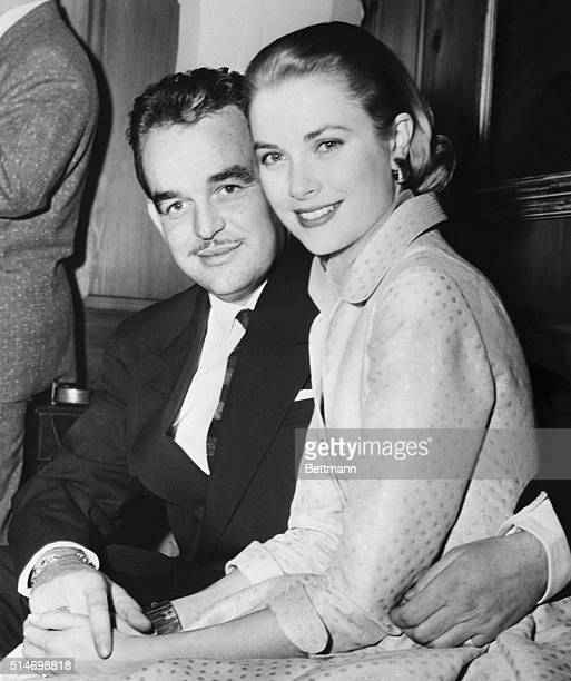 "Philadelphia, PA: Prince Rainier III of Monaco and lovely Grace Kelly, reigning ""Queen"" of the American screen, pose for photographers at the home of..."