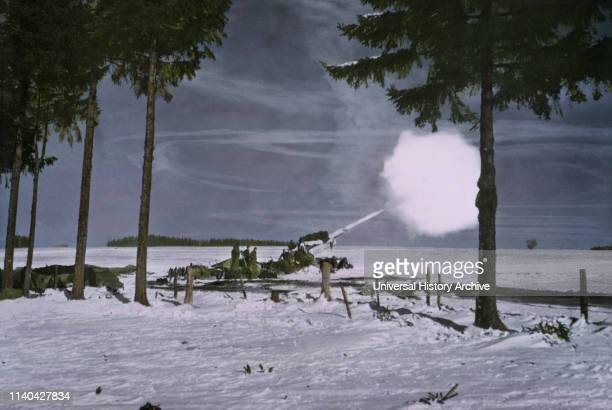 155mm Gun M1A1 with Barrel Camouflaged with White Cloth Firing ArdennesAlsace Campaign Battle of the Bulge 1945