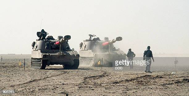 155mm self-propelled howitzers of the Egyptian army's 3rd Armored Brigade move into a holding area prior to decontamination during a field...