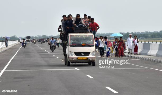 People travel on the DholaSadiya bridge across the River Lohit a tributary of the River Brahmaputra which was inaugurated by Indian Prime Minister...