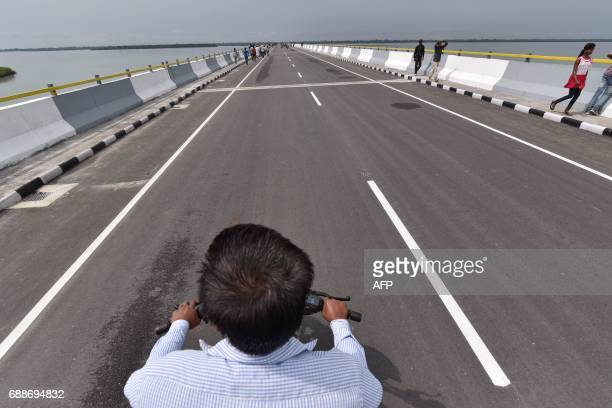 A driver rides his motorbike on the DholaSadiya bridge across the River Lohit a tributary of the River Brahmaputra which was inaugurated by Indian...