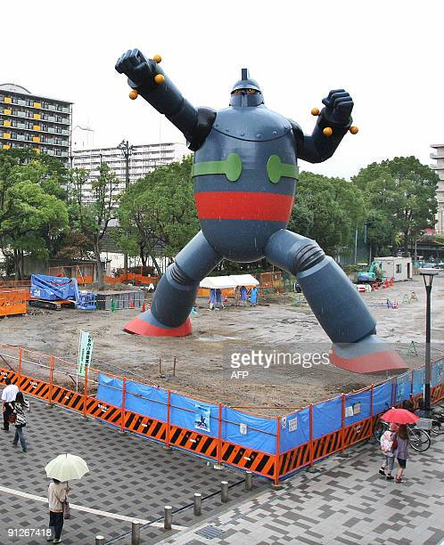 A 15meter tall robot statue 'Tetsujin 28go' or Ironman stands at a residential area in Kobe Hyogo prefecture western Japan on September 30 2009 for...
