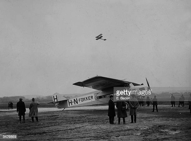 A Fokker plane which it is claimed will not nose dive if stalled is on the ground at Croydon Aerodrome In the air is an army Avro demonstrating a...