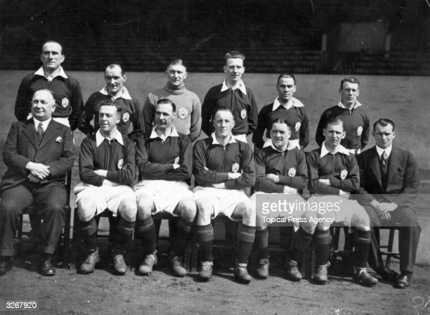 The Arsenal team group Tom Parker Jones goalkeeper Frank Moss Roberts John Tommy Black manager Herbert Chapman Joe Hulme David Jack Jack Lambert Alex...