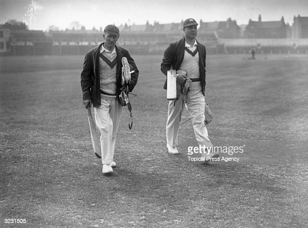 Harold Larwood and Bill Voce carrying their pads and bats to the nets at Trent Bridge.