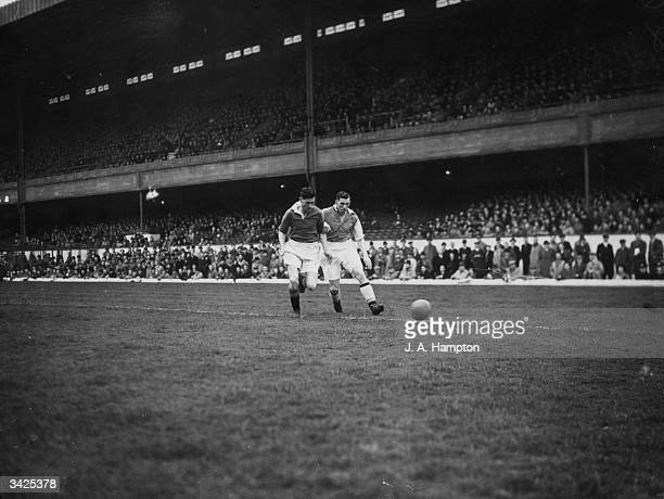 Arsenal player Alf Kirchen with Manchester United man Griffiths fighting for the ball during a match at Highbury