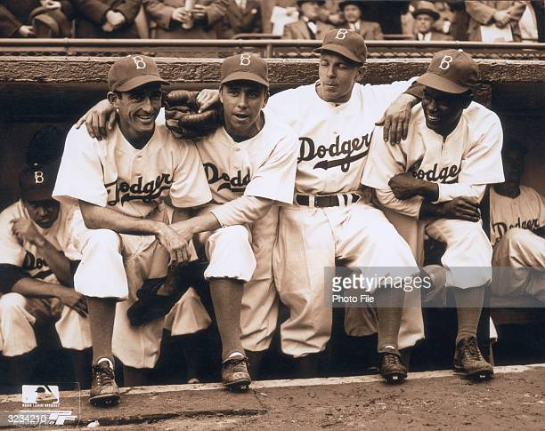Brooklyn Dodgers infielder and slugger Jackie Robinson poses with teammates Johnny 'Spider' Jorgensen, Harold 'Pee Wee' Reese and Eddie Stanky, on...