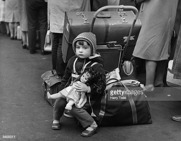 Two year old Evelyn Atkins waiting for a train at London's Waterloo Station