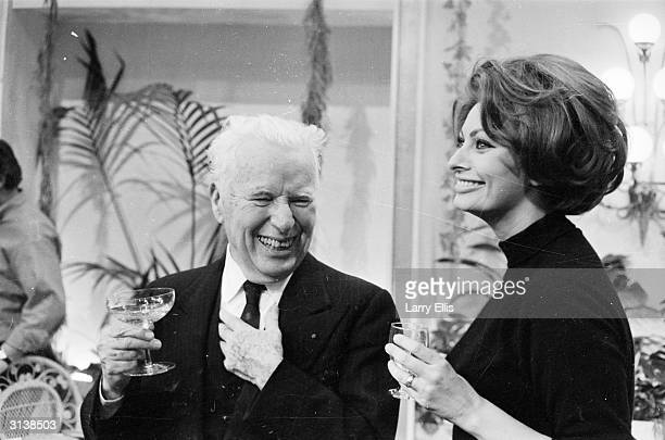 English born actor comedian and film maker Charlie Chaplin with Sophia Loren at his birthday party