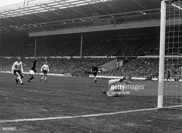 Bobby Lennox turns to celebrate scoring Scotland's second goal against England at Wembley as England captain Bobby Moore left watches beaten...