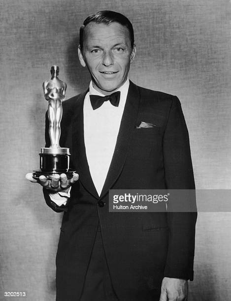 American actor and singer Frank Sinatra holds an Hersholt Humanitarian Award backstage at the Academy Awards Dorothy Chandler Pavilion Los Angeles...