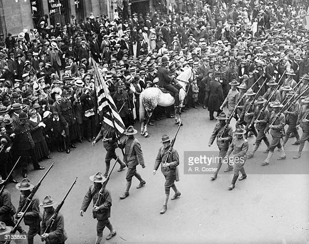 American troops marching through the streets of London watched by a welcoming crowd
