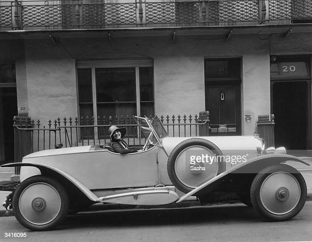 Edna Peters the 'Typical American Girl' sitting in a sports car