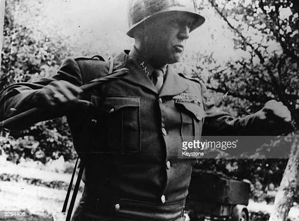 American General George Patton stresses a point during his conversation with war correspondents attached to his 3rd Army newly landed in France