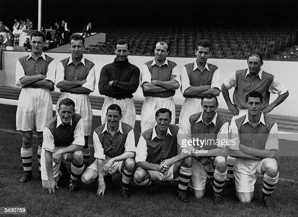 Arsenal footballers Ray Daniel Don Roper G Swindon W Barnes Doug Lishman and Freddie Cox A Forbes J Logie Joe Mercer L Smith and Cliff Holton