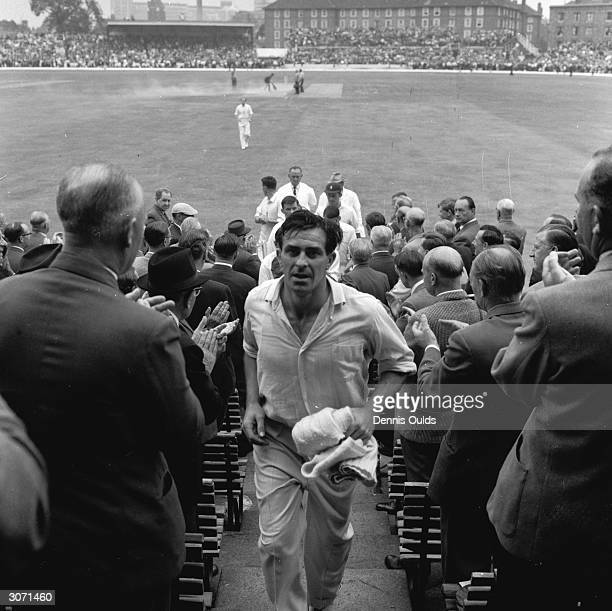 England fast bowler Freddie Trueman is applauded by fans as he comes into the pavilion after taking his 301st Test wicket in the final Test against...