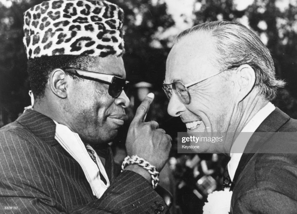 Prince Bernhard of the Netherlands joking with President Mobutu Sese Seko of Zaire, previously Joseph Desire Mobutu, after presenting the President with the Order of the Golden Arch.