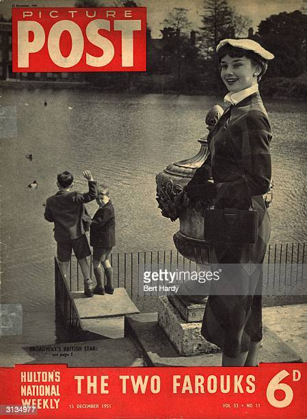 Actress Audrey Hepburn as a 22 year old and acclaimed for her Broadway appearance as Gigi She is watching ducks being fed by two young boys in Kew...