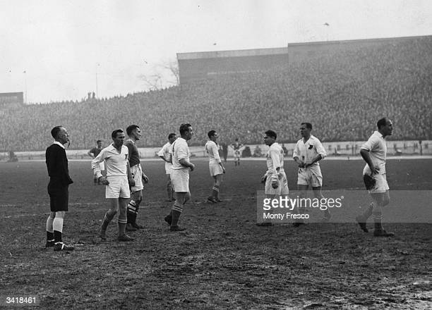 Players of the visiting Hungarian football team Voros Lobogo disagree with the referee's decision as Chelsea play Voros Lobogo at Stamford Bridge