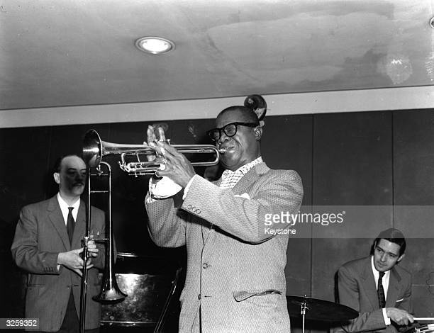 Louis 'Satchmo' Armstrong the great jazz trumpeter and vocalist plays trumpet during rehearsal for the Lord Mayor's Hungarian food relief concert at...