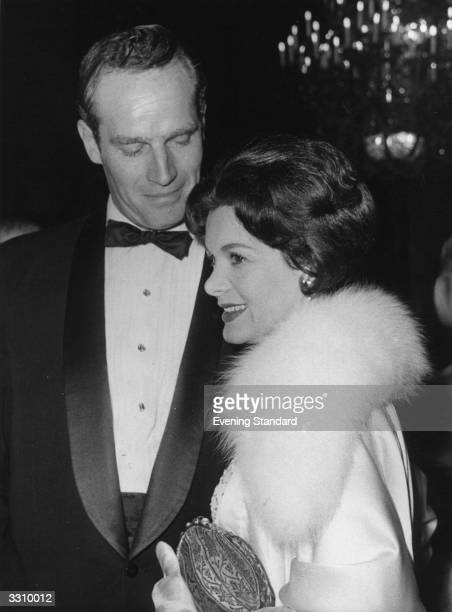 Film star Charlton Heston and his wife attend the film premiere of 'Ben Hur'