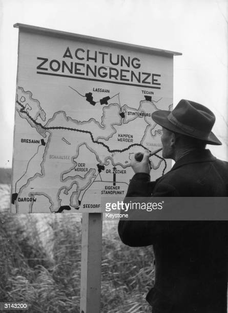 A sign near GrossZecher shows the exact location of the boundary between East and West Germany The German border control authorities have put up...