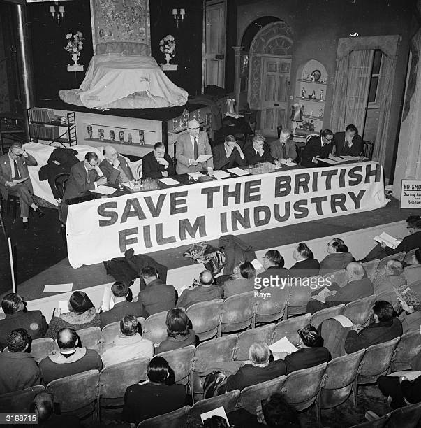 Tom O'Brien, General Secretary of NATKE at a union meeting. In 1970, NATKE became NATTKE with the addition of Television to its title. A banner...