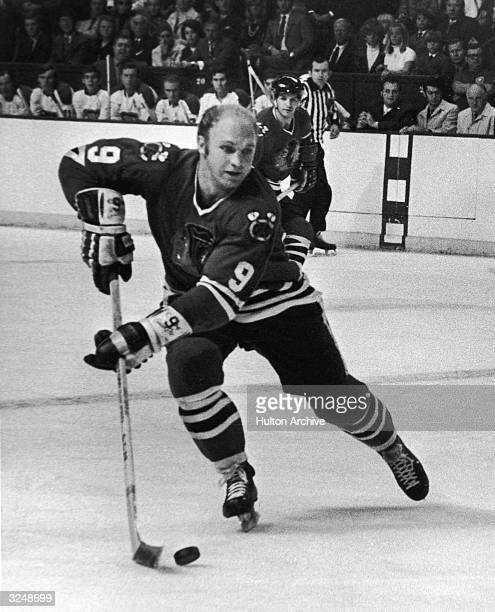 Canadian hockey player Bobby Hull left wing for the Chicago Blackhawks handles the puck during a game against the Montreal Canadiens