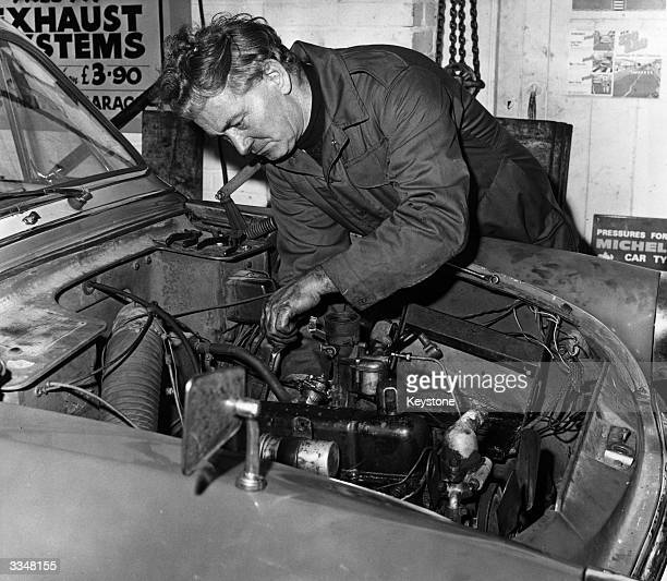 Blind mechanic Bert Newman dismantling a car engine at Sherwell garage in Torquay a job which he completed in 95 hours