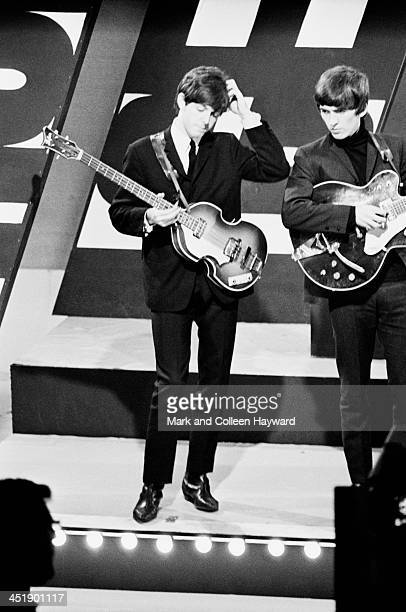 Paul McCartney and George Harrison from The Beatles perform at Alpha TV studios in Birmingham England during filming of ABC TV show 'Thank Your Lucky...