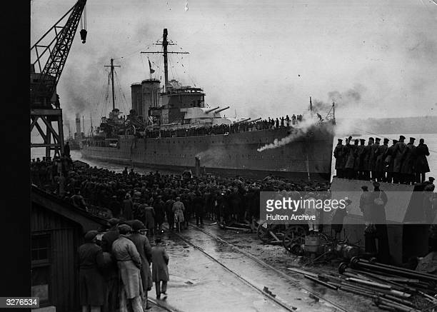 The British cruiser 'The Exeter' returning to port in Plymouth after bearing the brunt of the great battle with the German battleship 'Admiral Graf...