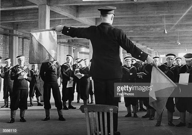 Officer cadets being taught how to semaphore.