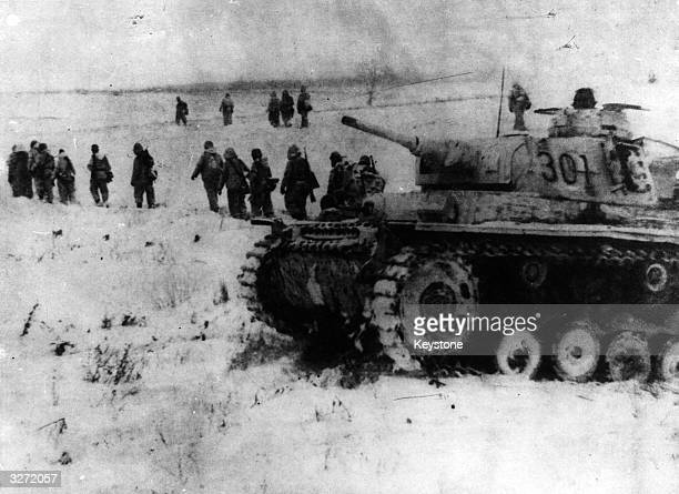 German infantry and a Panzer III battle tank prepare for a big attack by the Soviets in the Rostov area During the Russians' winter offensive Axis...