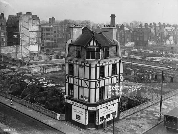 Buckea's bakers shop stands alone on the corner of Boswell Street and Theobalds Road Holborn after heavy bombing in the area during the Second World...
