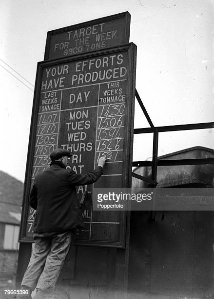 15th February 1947 Kent England A picture of a miner writing the weekly production totals on a blackboard as they are working hard to exceed their...