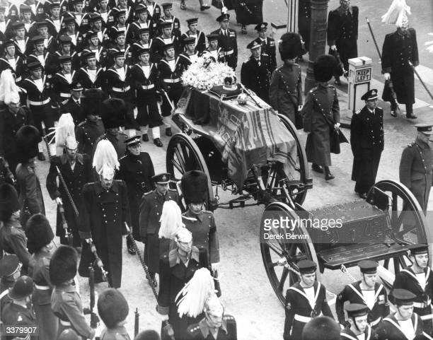 The coffin of King George VI lies on a gun carriage drawn by naval officers, and accompanied by men of the Household Cavalry. On top of the royal...