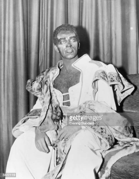 Welsh actor Richard Burton made up for his role as Othello at the Old Vic Theatre, London.