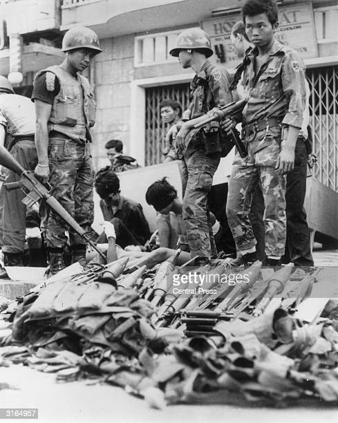 Viet Cong prisoners of war with their arms and ammunition after surrendering in Saigon