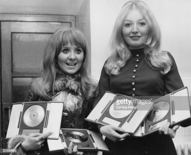 Two of Britain's top pop girls Glasgow born Lulu and Mary Hopkin from Wales clutching awards they were presented at the Disc And Music Echo...