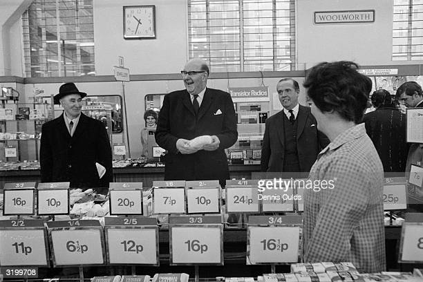 Lord Fiske Chairman of the Decimal Currency Board 'decimal shopping' at Woolworths in the Strand on the first day of national decimalisation